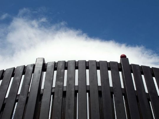 dark brown timber fence by Cranbourne Fencing Pros